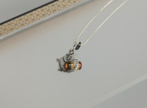 Silver pendant with amber - elephant.