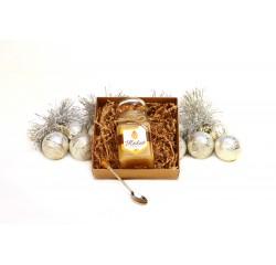 Kalėdinis lietuviškas medus ir šaukštelis su gintaro gabaliuku