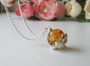 Amber pendant on a long chain