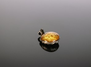 Silver pendant with natural amber