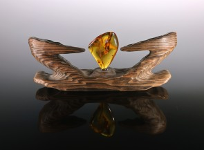 Wooden souvenir with natural amber