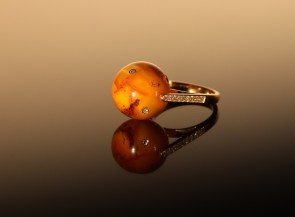 "Golden ring ""Polalis"" with amber, ruby, sapphire and diamonds"